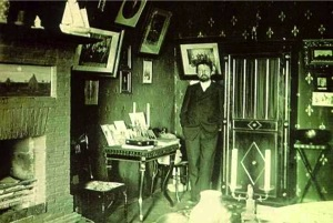Chekhov standing in his study in Yalta. Levitan's sketch is visible on the left above the fireplace.